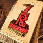Auftragsarbeit für Raleigh Univega. Schild in Steintafel eingesetzt mit vertiefter Schrift.